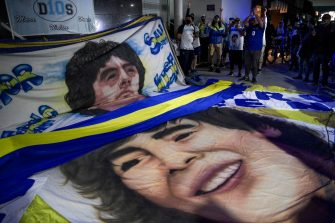 Supporters of Argentine former football star and coach of Gimnasia y Esgrima La Plata Diego Maradona gather outside the hospital where he undergoes a brain surgery for a blood clot, in Olivos, Buenos Aires province, on November 3, 2020. (Photo by JUAN MABROMATA / AFP) (Photo by JUAN MABROMATA/AFP via Getty Images)