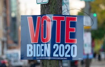 epaselect epa08797113 A sign supporting Joe Biden hangs in Philadelphia, Pennsylvania, USA, 03 November 2020. Americans vote on Election Day to choose between re-electing Donald J. Trump or electing Joe Biden as the 46th President of the United States to serve from 2021 through 2024.  EPA/TRACIE VAN AUKEN