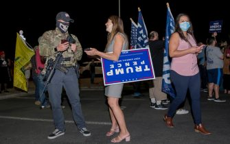 epaselect epa08802073 Trump supporters, including a small group of Second Amendment demonstrators, gather outside of the Maricopa County Recorder's Office to demand all ballots be counted in Phoenix, Arizona, USA, 05 November 2020. The 2020 US Presidential Election result remains undetermined as votes continued to be counted in several key battleground states.  EPA/RICK D'ELIA