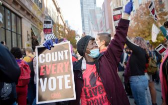 epaselect epa08801513 People rally to demand that every vote be counted outside of the Pennsylvania Convention Center in Philadelphia, Pennsylvania, USA, 05 November 2020. Counting of mail-in ballots in Pennsylvania began on 03 November and is expected to stretch to 06 November.  EPA/TRACIE VAN AUKEN