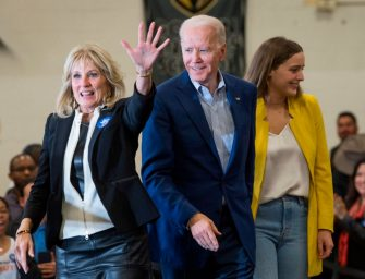Democratic presidential hopeful former Vice President Joe Biden, walks onto the stage with his wife Jill and grandaughter Finnegan during a community event at the Hyde Park Middle School on the eve of the caucus in Las Vegas, Nevada, on February 21, 2020. (Photo by Mark RALSTON / AFP) (Photo by MARK RALSTON/AFP via Getty Images)