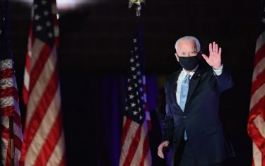 US President-elect Joe Biden waves as he arrives to deliver remarks in Wilmington, Delaware, on November 7, 2020. - Democrat Joe Biden was declared winner of the US presidency November 7, defeating Donald Trump and ending an era that convulsed American politics, shocked the world and left the United States more divided than at any time in decades. (Photo by Angela Weiss / AFP) (Photo by ANGELA WEISS/AFP via Getty Images)