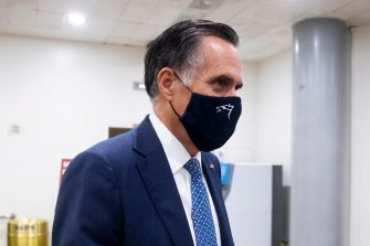 epa08689137 Republican Senator from Utah Mitt Romney walks near the Senate subway after leaving the Senate chamber, on Capitol Hill in Washington, DC, USA, 22 September 2020. Romney has said he supports a Senate floor vote on Trump's nominee to replace the late US Supreme Court Justice Ruth Bader Ginsburg, clearing the way for the Senate to consider Trump's choice despite the impending presidential election.  EPA/MICHAEL REYNOLDS