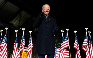 (FILES) In this file photo taken on November 2, 2020 Democratic Presidential candidate and former US Vice President Joe Biden gestures after speaking during a Drive-In Rally at Heinz Field in Pittsburgh, Pennsylvania. - Joe Biden has won the US presidency over Donald Trump, TV networks projected on November 7, 2020, a victory sealed after the Democrat claimed several key battleground states won by the Republican incumbent in 2016. CNN, NBC News and CBS News called the race in his favor, after projecting he had won the decisive state of Pennsylvania. His running mate, US Senator Kamala Harris, has become the first woman US Vice President elected to the office. (Photo by JIM WATSON / AFP)
