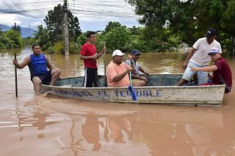epa08803726 Inhabitants of the El Campin neighborhood get out our their belongings after their houses flood caused by Hurricane Eta, in the city of San Manuel, Honduras, 06 November 2020. The tropical depression Eta, which left Honduras on 05 November, has left a trail of pain for a score of deaths and millionaire losses to infrastructure and economy that have not yet been quantified, in a country also hit by the covid-19 pandemic and is now calling for international aid.  EPA/Jose Valle