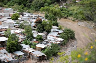 epa08805937 A view of a neighborhood on the bank of the Choluteca river, in Tegucigalpa, Honduras, 07 November 2020. The devastating passage of the tropical depression Eta through Honduras, which leaves more than twenty dead.  EPA/Gustavo Amador