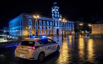 epa08774307 A local police vehicle crosses Puerta del Sol square after a curfew was imposed in downtown Madrid, Spain, early 26 October 2020. A curfew from midnight to 06:00 am was imposed from last night in Madrid, after central Government's declared a new state of emergency in the country. Madrid's regional authorities have imposed mobility restrictions in 32 areas, as well, to try to avoid the spreading of COVID-19 virus disease.  EPA/Rodrigo Jimenez
