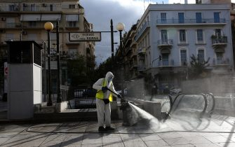 epa08807130 A municipal worker disinfects the Victoria square in Athens, Greece, 08 November 2020. New restrictions have been enforced in Athens amid a second wave of COVID-19 infections sweeping through Europe.  EPA/ORESTIS PANAGIOTOU