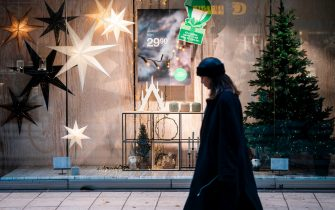 A woman passes a Christmas decorated shopping window in central Stockholm on November 10, 2020, amid the novel coronavirus COVID-19 pandemic. (Photo by Fredrik SANDBERG / TT News Agency / AFP) / Sweden OUT (Photo by FREDRIK SANDBERG/TT News Agency/AFP via Getty Images)