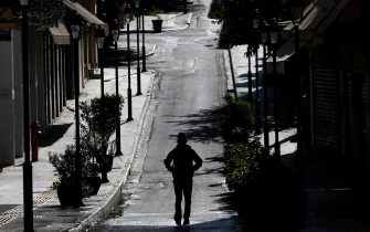 epa08804523 A man walks in the deserted Monastiraki district on the first day of the Covid-19 lockdown imposed by the Greek government, in Athens, Greece, 07 November 2020. Greek Prime Minister Kyriakos Mitsotakis announced a ban on public movement as of 06:00 on 07 November introducing the strictest measure, to stem the spread of the coronavirus pandemic in Greece.  EPA/ORESTIS PANAGIOTOU