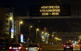 epa08819095 An illuminated sign over an Athens highway reminds drivers of an overnight curfew, Greece, 13 November 2020. An overnight curfew, starting on 13 November, will come into effect across the country between 21:00 and 05:00 everyday, with specific exceptions - work, health and walking pets, to stem the spread of the Covid-19 coronavirus pandemic. Greece is currently observing a nationwide lockdown that went into effect on 07 November and will remain effective through 30 November. During this time, citizens must request a permit for their outings, issued via SMS messaging.  EPA/ALEXANDROS BELTES