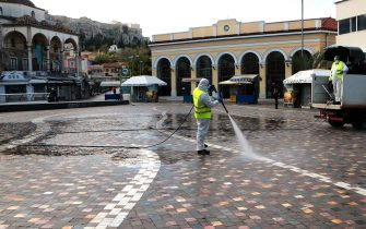 epa08804017 A municipal worker disinfects the empty Monastiraki Square on the first day of the lockdown in Athens, Greece, 07 November 2020. Greek Prime Minister Kyriakos Mitsotakis announced a ban on public movement as of 06:00 on 07 November introducing the strictest measure, to stem the spread of the coronavirus pandemic in Greece.  EPA/PANTELIS SAITAS
