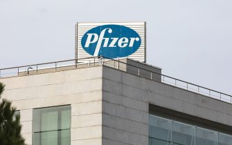 ALCOBENDAS, SPAIN – NOVEMBER 12: A sign for Pfizer is seen outside the Pfizer building on November 12, 2020 in Alcobendas, Madrid, Spain.  Pharmaceutical company Pfizer announced positive early results on its Covid-19 vaccine trial and has proven to be 90% effective in preventing infection of the virus. (Photo by David Benito/Getty Images)