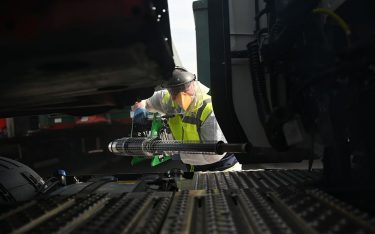 Business owner Chris Johnson uses a thermal fogger to disinfect trucks at a haulage firm in Barnsley,  south Yorkshire on April 22, 2020, during the nationwide lockdown due to the novel coronavirus COVID-19 pandemic. - Oxford University is launching a human trial of a potential coronavirus vaccine, with the daunting aim of making a succesful jab available to the public later this year. (Photo by Oli SCARFF / AFP) (Photo by OLI SCARFF/AFP via Getty Images)