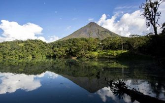 epa08640084 View of the Arenal volcano, one of the tourist attractions in La Fortuna de San Carlos area, north of San Jose, Costa Rica, 28 August 2020 (issued 01 September 2020). The imposing Arenal volcano, its hot springs, the forests and landscapes that surround it, form a mix so that wellness tourism becomes one of the bases with which Costa Rica wants to lift the tourism sector that has been hard hit by the COVID-19 pandemic crisis.  EPA/Jeffrey Arguedas