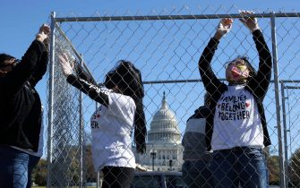 WASHINGTON, DC - NOVEMBER 16: Volunteers from pro-immigration group Families Belong Together build a chainlink cage to fill with about 600 teddy bears 'representing the children still separated as a result of U.S. immigration policies' on the National Mall November 16, 2020 in Washington, DC. Organized by the National Domestic Workers Alliance, Families Belong Together was formed in 2018 in response to the Trump Administration's policy of separating children from their parents after they enter the U.S. to seek refuge, resulting in hundreds of children unable to be reunited with their families because of poor administration and tracking. (Photo by Chip Somodevilla/Getty Images)