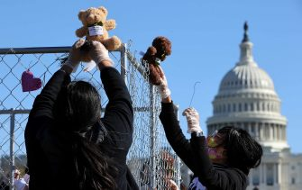 WASHINGTON, DC - NOVEMBER 16: Volunteers from pro-immigration group Families Belong Together build and fill a chainlink cage with about 600 teddy bears 'representing the children still separated as a result of U.S. immigration policies' on the National Mall November 16, 2020 in Washington, DC. Organized by the National Domestic Workers Alliance, Families Belong Together was formed in 2018 in response to the Trump Administration's policy of separating children from their parents after they enter the U.S. to seek refuge, resulting in hundreds of children unable to be reunited with their families because of poor administration and tracking. (Photo by Chip Somodevilla/Getty Images)