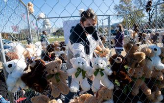 Volunteers and staff with Families Belong Together and the Franciscan Action Network (FAN), install more than 600 teddy bears in a chain-link cage to represent children separated from their families by US immigration policies, during a protest exhibit near the US Capitol in Washington, DC, November 16, 2020. (Photo by SAUL LOEB / AFP) (Photo by SAUL LOEB/AFP via Getty Images)