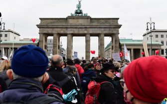 epa08826592 Protesters gather during a demonstration against German coronavirus restrictions, in front of the Brandenburg Gate in Berlin, Germany, 18 November 2020. While the German interior minister prohibited demonstrations around the Reichstag building during the parliamentary Bundestag session people gathered to protest against government-imposed semi-lockdown measures aimed at curbing the spread of the coronavirus pandemic. Since 02 November, all restaurants, bars, cultural venues, fitness studious, cinemas and sports halls are forced to close for four weeks as a lockdown measure to rein in skyrocketing coronavirus infection rates.  EPA/FILIP SINGER