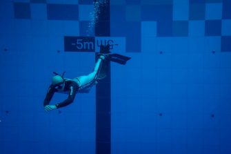 A diver is seen in the deepest pool in the world with 45.5-metre (150-foot) located in Mszczonow about 50 km from Warsaw, November 21, 2020. - The complex, named Deepspot, even includes a small wreck for scuba and free divers to explore. It has 8,000 cubic metres of water -- more than 20 times the amount in an ordinary 25-metre pool. (Photo by Wojtek RADWANSKI / AFP) (Photo by WOJTEK RADWANSKI/AFP via Getty Images)