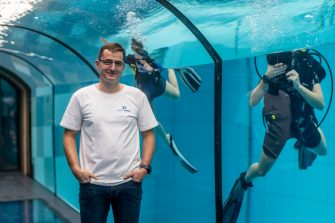 Deepspot director Michal Braszczynski poses at the deepest pool in the world with 45.5-metre (150-foot) located in Mszczonow about 50 km from Warsaw, November 21, 2020. - The complex, named Deepspot, even includes a small wreck for scuba and free divers to explore. It has 8,000 cubic metres of water -- more than 20 times the amount in an ordinary 25-metre pool. (Photo by Wojtek RADWANSKI / AFP) (Photo by WOJTEK RADWANSKI/AFP via Getty Images)