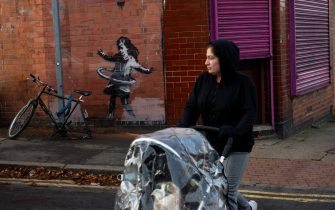 An artwork painted by Banksy on the side of a property at Rothesay Avenue and Ilkeston Road in Nottingham, which has had a replacement bicycle after the original was reportedly stolen over the weekend. Picture date: Monday 23rd November 2020. Photo credit should read: Jacob King/PA Wire (Nottingham - 2020-11-23, Jacob King / IPA) p.s. la foto e' utilizzabile nel rispetto del contesto in cui e' stata scattata, e senza intento diffamatorio del decoro delle persone rappresentate