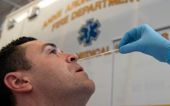 epa08726863 A paramedic with Anne Arundel County Fire Department receives a COVID-19 test in Glen Burnie, Maryland, USA, 07 October 2020. Emergency Medical Professionals continue to battle the COVID-19 Pandemic as the number of cases and deaths continues to rise globally.  EPA/ALEX EDELMAN