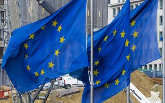 epa05167858 European flags fly in front of a building construction in the European district in Brussels, Belgium, 18 February 2016. EU leaders were set to try to thrash out an agreement with Britain on reforms, amid hopes that they can seal a deal which will convince the country to stay in their bloc. Fears are rife that Britons might vote to leave the European Union in a referendum that Prime Minister David Cameron has promised to hold by the end of 2017, but that is widely expected this year already. The turmoil over Brexit - the buzzword for Britain's possible departure from the EU after more than 40 years of half-hearted membership - comes at a time when the bloc is already struggling with a severe migration crisis and enduring economic woes.  EPA/OLIVIER HOSLET