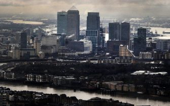 epa05176875 (FILE) A file photo dated 01 February 2013 shows dark clouds above London's financial heart, Canary Wharf, in London, Britain. A group of more than 100 leaders of major businesses on 23 February 2016 backed Prime Minister David Cameron's campaign for Britain to remain in the European Union, saying a British exit, or Brexit, would 'deter investment and threaten jobs.' 'Business needs unrestricted access to the European market of 500 million people in order to continue to grow, invest and create jobs,' the business leaders said in a letter published in the Times. 'We believe that leaving the EU would deter investment, threaten jobs and put the economy at risk,' the letter read. The nearly 200 signatories included top executives from 36 companies listed on London's FTSE 100 index.  EPA/ANDY RAIN