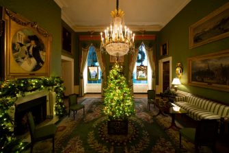 """WASHINGTON, DC - NOVEMBER 30: A Christmas tree and decorations are on display in the Green Room of the White House on November 30, 2020 in Washington, DC. This year's theme for the White House Christmas decorations is """"America the Beautiful."""" (Photo by Drew Angerer/Getty Images)"""