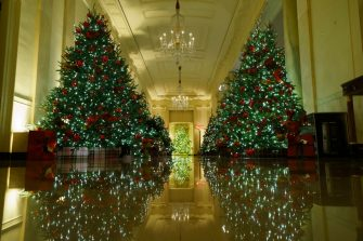 """WASHINGTON, DC - NOVEMBER 30: Christmas decorations are on display in the Cross Hall of the White House on November 30, 2020 in Washington, DC. This year's theme for the White House Christmas decorations is """"America the Beautiful."""" (Photo by Drew Angerer/Getty Images)"""