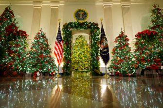"""WASHINGTON, DC - NOVEMBER 30: Christmas decorations are on display in the Cross Hall and Blue Room of the White House on November 30, 2020 in Washington, DC. This year's theme for the White House Christmas decorations is """"America the Beautiful."""" (Photo by Drew Angerer/Getty Images)"""