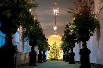 """WASHINGTON, DC - NOVEMBER 30: The East Colonnade is decorated for Christmas at the White House on November 30, 2020 in Washington, DC. This year's theme for the White House Christmas decorations is """"America the Beautiful."""" (Photo by Drew Angerer/Getty Images)"""