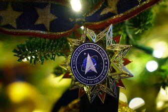 """WASHINGTON, DC - NOVEMBER 30: A U.S. Space Force themed ornament hangs on a Christmas tree at the White House on November 30, 2020 in Washington, DC. This year's theme for the White House Christmas decorations is """"America the Beautiful."""" (Photo by Drew Angerer/Getty Images)"""