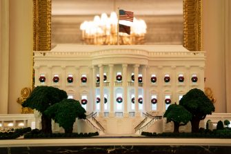 """WASHINGTON, DC - NOVEMBER 30: A White House gingerbread house is displayed in the State Dining Room of the White House on November 30, 2020 in Washington, DC. This year's theme for the White House Christmas decorations is """"America the Beautiful."""" (Photo by Drew Angerer/Getty Images)"""