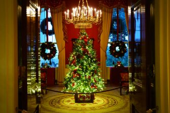 """WASHINGTON, DC - NOVEMBER 30: A Christmas tree and decorations are on display in the Red Room of the White House on November 30, 2020 in Washington, DC. This year's theme for the White House Christmas decorations is """"America the Beautiful."""" (Photo by Drew Angerer/Getty Images)"""