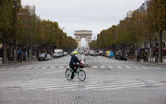 """People drive their cars on the avenue des Champs-Elysee leading to the Arch of Triumph in Paris, France on October 30, 2020. The traffic looks almost as usual despite a second lockdown came into force at midnight on Friday (23:00 GMT) to tackle spiralling Covid infections. People have been ordered to stay at home except for essential work or medical reasons. President Emmanuel Macron said the country risked being """"overwhelmed by a second wave that no doubt will be harder than the first"""". Photo by Raphael Lafargue/ABACAPRESS.COM (Paris - 2020-10-30, Lafargue Raphael/ABACA / IPA) p.s. la foto e' utilizzabile nel rispetto del contesto in cui e' stata scattata, e senza intento diffamatorio del decoro delle persone rappresentate"""