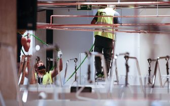 Workers are seen placing wiring at the temporary field hospital in the National Stadium in Warsaw, Poland on October 29, 2020. Prime Minister Mateusz Morawiecki together with Minister of Healt Adam Niedzielski and medical director Artur Zaczynski on Thursday visited the field hospital at the National Stadium in Warsaw. The temporary hospital will provide 500 beds to COVID-19 patients to help alleviate demands on regular hospitals amid shaprly rising cases of infections. (Photo by Jaap Arriens / Sipa USA) (Warsaw - 2020-10-29, Jaap Arriens / IPA) p.s. la foto e' utilizzabile nel rispetto del contesto in cui e' stata scattata, e senza intento diffamatorio del decoro delle persone rappresentate