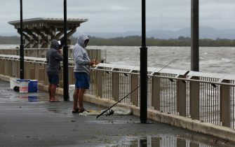 epa08882966 People fish in Morton Bay at Redcliffe, Queensland, Australia, 14 December 2020. Strong wind and rain warnings have been issued for Queensland and northern New South Wales, with potentially serious flooding and dangerous surf also being forecast.  EPA/DANNY CASEY AUSTRALIA AND NEW ZEALAND OUT