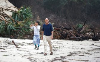 BYRON BAY, AUSTRALIA - DECEMBER 14:  A couple walk past the stretch of coastal areas seen damaged due to erosion along the beach side, December 14, 2020 in Byron Bay, Australia. Byron Bay's beaches face further erosion as wild weather and hazardous swells lash the northern NSW coastlines. (Photo by Regi Varghese/Getty Images)