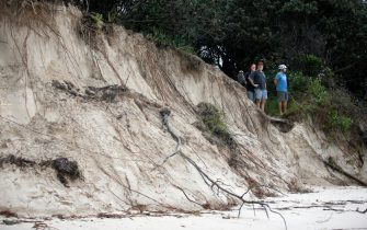 BYRON BAY, AUSTRALIA - DECEMBER 14:  Local residents check the damage along the stretch of beaches due to erosion, December 14, 2020 in Byron Bay, Australia. Byron Bay's beaches face further erosion as wild weather and hazardous swells lash the northern NSW coastlines. (Photo by Regi Varghese/Getty Images)