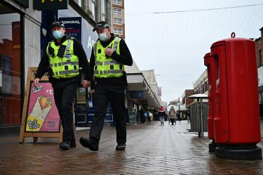 MOTHERWELL, SCOTLAND - OCTOBER 29: Police officers walk through the town centre on October 29, 2020 in Motherwell, Scotland. The levels of coronavirus restrictions to be placed on each of Scotland's 32 local council areas are to be confirmed later. Provisional tiers published earlier this week suggested North and South Lanarkshire could both be placed in the highest level four category. (Photo by Jeff J Mitchell/Getty Images)