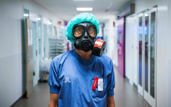 Karin Hildebrand, a doctor in an intensive care unit (ICU) in Stockholm's Sodersjukhuset hospital is pictured with a protective face mask on June 11, 2020, during the coronavirus COVID-19 pandemic. (Photo by Jonathan NACKSTRAND / AFP)