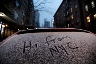 epa08889091 A message written in snow on a car window on Manhattan's west side in New York, New York, USA, 16 December 2020. Forecasters are predicting up to 14 inches of snow with strong winds that could create blizzard-like conditions. A winter weather advisory is in effect.  EPA/PETER FOLEY