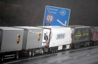 epa08897806 Lorries headed to the Port of Dover are stacked along the M20 motorway in Kent, Britain, 21 December 2020. France has closed its border with the UK for 48 hours over concerns about the new coronavirus variant. Freight lorries cannot cross by sea or through the Eurotunnel and the Port of Dover has closed to outbound traffic.  EPA/NEIL HALL