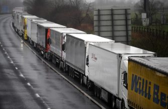 epa08897804 Lorries headed to the Port of Dover are stacked along the M20 motorway in Kent, Britain, 21 December 2020. France has closed its border with the UK for 48 hours over concerns about the new coronavirus variant. Freight lorries cannot cross by sea or through the Eurotunnel and the Port of Dover has closed to outbound traffic.  EPA/NEIL HALL