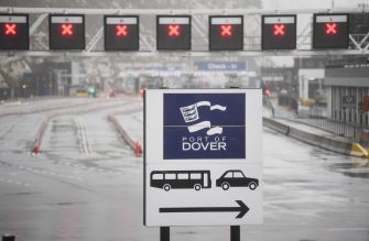 epa08897834 The entrance to the Port of Dover is closed in Dover, Britain, 21 December 2020. France has closed its border with the UK for 48 hours over concerns about the new coronavirus variant. Freight lorries cannot cross by sea or through the Eurotunnel and the Port of Dover has closed to outbound traffic.  EPA/NEIL HALL