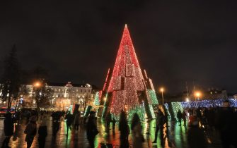 An illuminated Christmas tree is seen on November 28, 2020 near the cathedral in Vilnius. (Photo by PETRAS MALUKAS / AFP) (Photo by PETRAS MALUKAS/AFP via Getty Images)