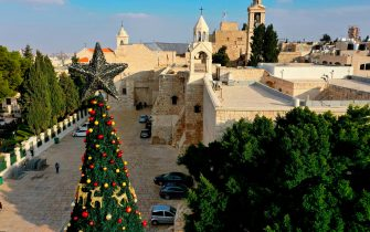 An aerial view taken on December 22, 2020, shows the Christmas tree in front of the Church of the Nativity, in the Palestinian holy city of Bethlehem in the West Bank. (Photo by HAZEM BADER / AFP) (Photo by HAZEM BADER/AFP via Getty Images)