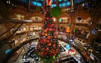 PARIS, FRANCE - NOVEMBER 19: A giant Christmas tree is seen at the empty Galeries Lafayette store on November 19, 2020 in Paris, France. Les Galeries Lafayette store has been closed along with all other non-essential shops since October 30th , 2020 when France imposed another national lockdown for a minimum four weeks as part of the Covid-19 measures to fight a second wave of coronavirus disease. (Photo by Pascal Le Segretain/Getty Images)